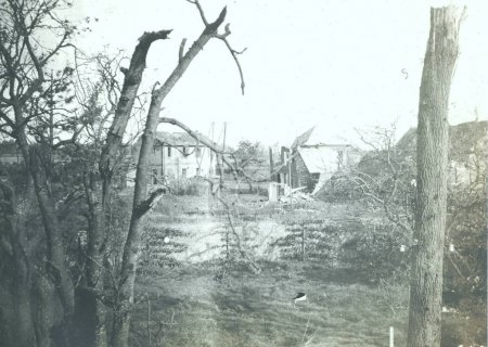 View of damaged houses in village after attack
