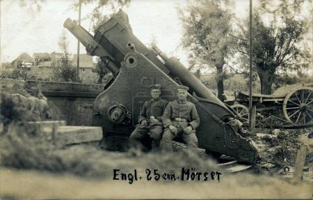 Two german soldiers posing in front of british 10 inch mortar