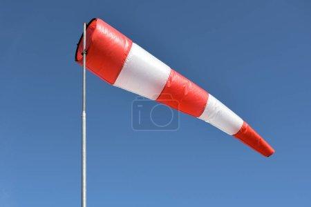 Wind cone against blue sky