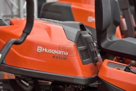 Husqvarna garden tractor and logo