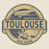 Stamp or tag with airplane and text Welcome to Toulouse France