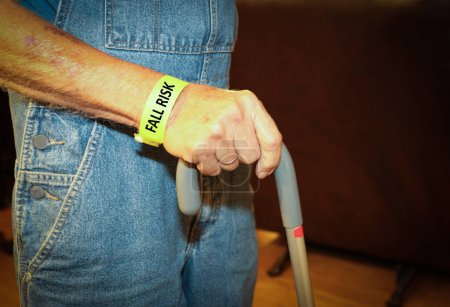 Elderly Man A Fall risk Walking With A Cane