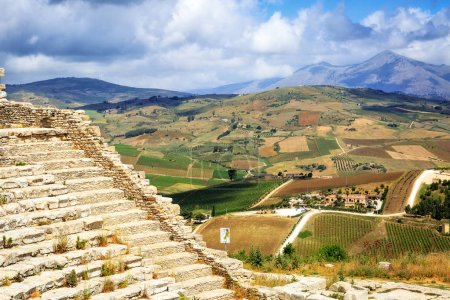 amphitheater ruins on top of a hill overlooking the beautiful city of Segesta in Sicily, Italy