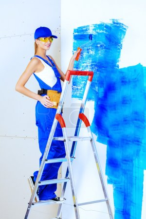 painting walls. Repair, construction and mortgage concept.