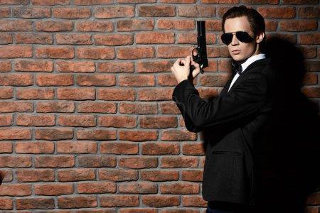 security man  holding a gun.