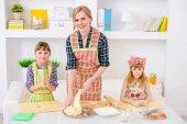 Three hostesses cook