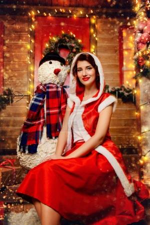 pretty girl with snowman
