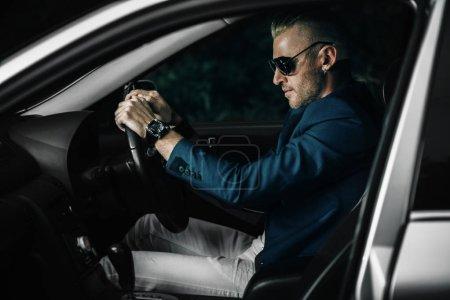 handsome man driving car