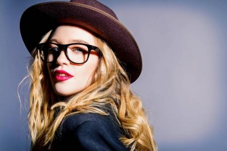 trendy glasses and hat