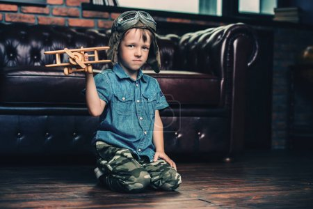kid in fathers hat