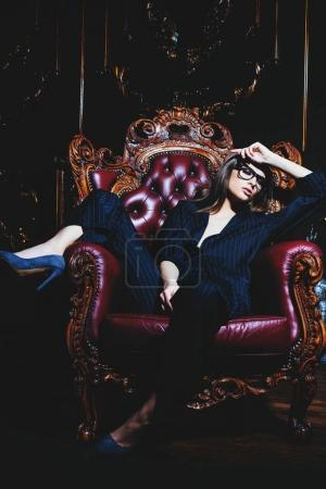 sexy girl in armchair