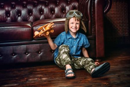 kid plays in pilot