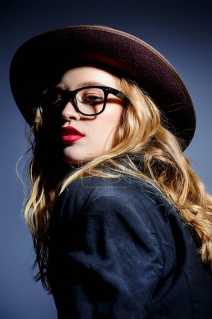girl in hat and glasses