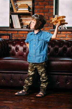 kid playing with airplane