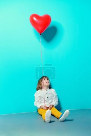 lad with balloon