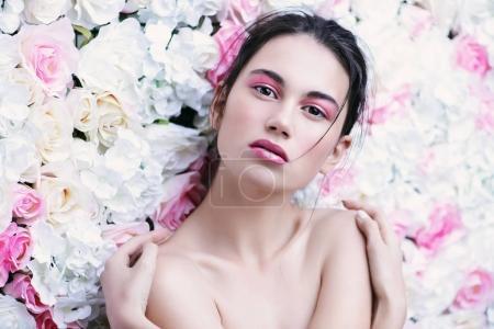 brunette on floral background