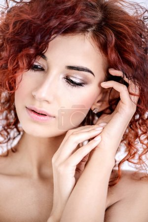Photo for Beauty, hair concept. Beautiful joyful young woman with bright red curly hair and healthy shiny skin. White background. - Royalty Free Image