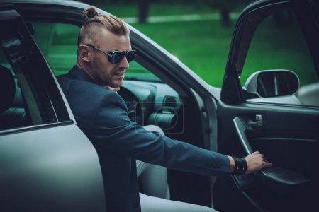 stylish man in car