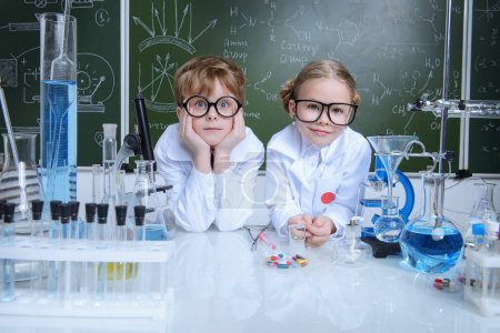 Photo for Two children scientists making experiments in the laboratory. Educational concept. Early development of children. - Royalty Free Image