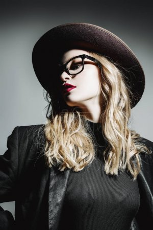 lady with glasses and hat