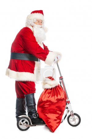 Photo for A portrait of Santa Claus with a scooter and bag gifts. Merry Christmas and Happy New Year! - Royalty Free Image