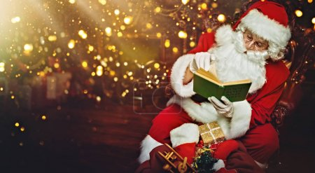 Photo for Santa Claus brought gifts for Christmas and he checks his notebook with a list of good children. Beautiful Christmas interior. Christmas and New Year concept. - Royalty Free Image