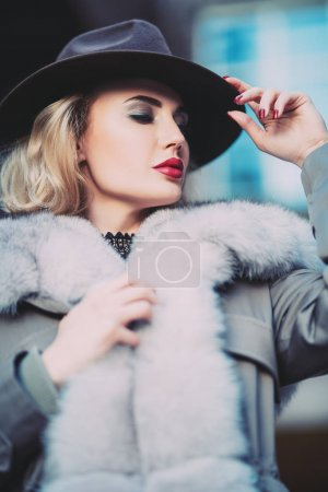 Photo for A portrait of a beautiful blonde lady walking in the street. Beauty, urban fashion, style. - Royalty Free Image