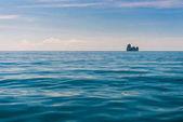blue sea water and a small island on the horizon, Krabi, Thailan
