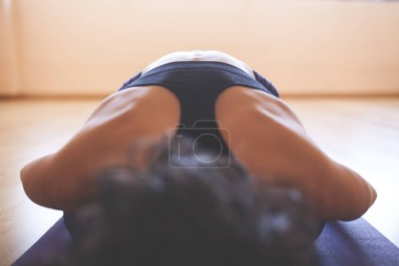 Photo for Yogi lying face down with hands extended forward - Royalty Free Image