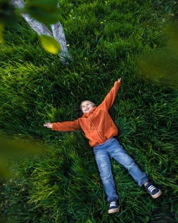 Happy child playing on grass