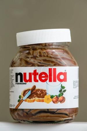 Kyiv, Ukraine - May 14th, 2016: Jar of Nutella Hazelnut on a bokeh background. Nutella is the brand name of a chocolate hazelnut