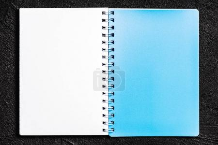 Photo for Notepad located on black background - Royalty Free Image