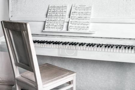 White piano. Music concept