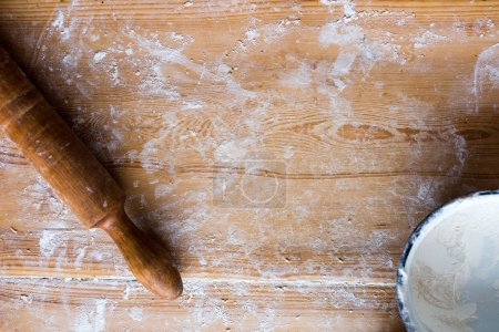 Ingredients for cooking baking - flour, dough on wooden background