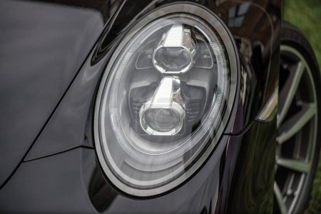 Close-up of headlights of a car