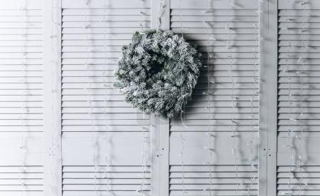 New Year wreath on a light wooden background. Christmas and New Year concept