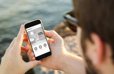 man browsing design website on smartphone