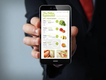 online supermarket businessman smartphone