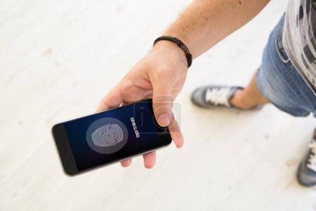 male hands fingerprint unlock smartphone