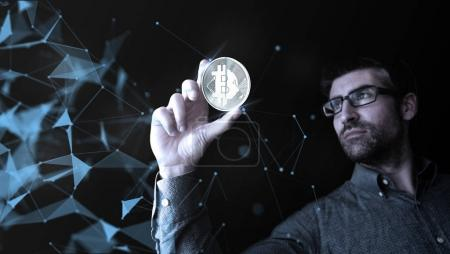 man holding digital bitcoin, cryptocurrency concept