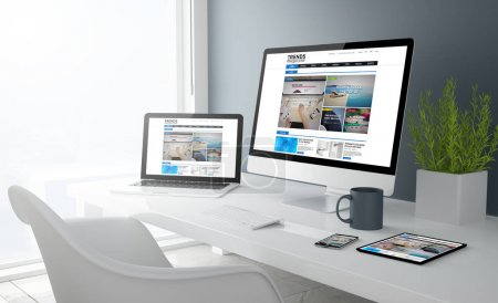 computer, laptop, smartphone and tablet pc on workspace with online magazine website on screens, 3d rendering