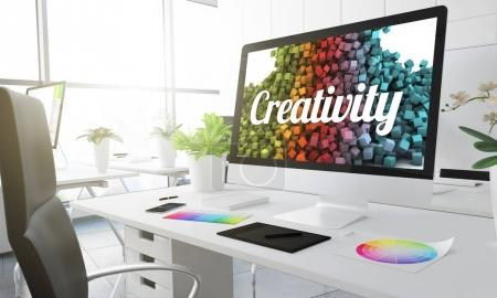 creativity text and bright background  on computer screen, creative studio workplace with colour swatches on the table, 3d rendering