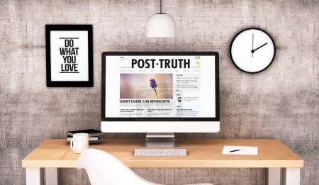 3d rendering of modern workspace with computer screen showing post truth website