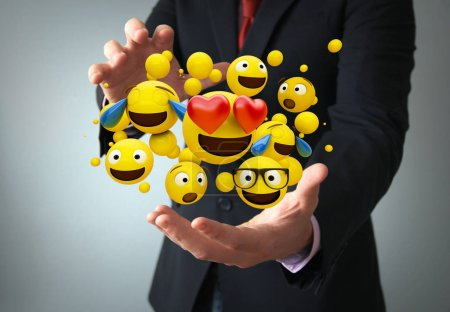communications concept: emoticons on the hand of a businessman