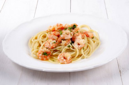 Close-up of tasty Spaghetti with sauce and seafood...