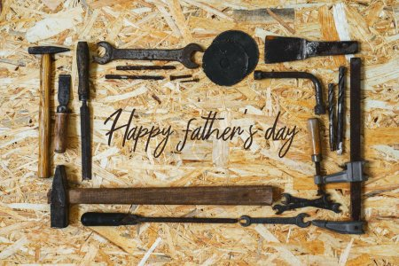 Photo for Concept for the Happy Father's Day holiday. Old vintage carpenter's construction tools on a wooden surface. - Royalty Free Image