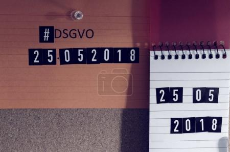 Board with the inscription Hashtag #DSGVO (General Data Protection Regulation) in English GDPR (General Data Protection Regulation) with a laptop and padlock for the introduction of the DSGVO in the EU on 25.05.2018