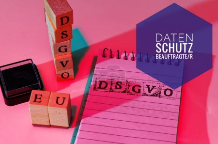 Block and blocks labeled DSGVO EU (DSGVO, Datenschutzbeauftragter) in English GDPR (General Data Protection Regulation, data protection commissioner) for the introduction of the DSGVO in the EU on 25.05.2018