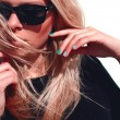 Fashion hipster girl in cool sunglasses....