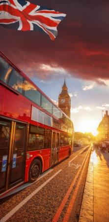 Double decker bus against Big Ben with colorful sunset in London, England, UK